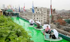 Shop and row! Selfridges unveils boats and cocktail bar on rooftop terrace -cocktail on boat - different ways to use a pool for cocktails & team building-