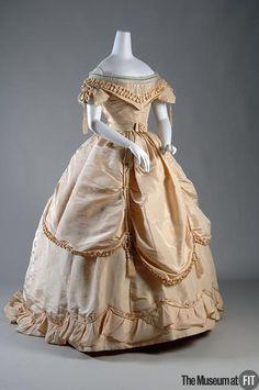 Evening Dress, ca. 1865, Scottish; cream silk taffeta, satin, tulle, cording and tassels and black silk ribbon, via the Museum at FIT