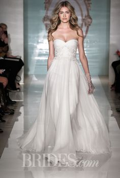 """Brides.com: Reem Acra - Spring 2015. Reem Acra on her Spring 2015 collection, """"Mirror, Mirror..."""":  """"The superb Reem Acra Spring 2015 bridal collection solves the dilemma of today's bride: choosing her look on the most important day of her life!  And, what is that look? Trendy, classic, sexy, timeless? All of these questions are answered in the variety of shapes and attention to detail in this new important season. Diversity of fabrication offers many choices for the bride. Stretch duchess ...."""