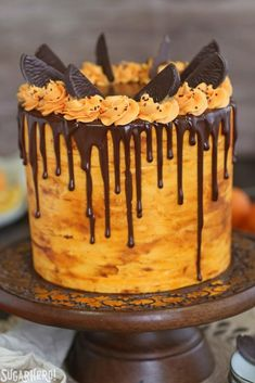 Chocolate-Orange Cake - tall chocolate cake frosted with orange buttercream and a drippy chocolate glaze   From SugarHero.com