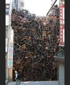"""""""1550 Chairs Stacked Between Two City Buildings"""" is an installation by Doris Salcedo at Istanbul Biennial."""