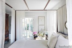 """Choose a Big Bed: """"As long as there's room for an end table, it actually makes the room look bigger."""""""