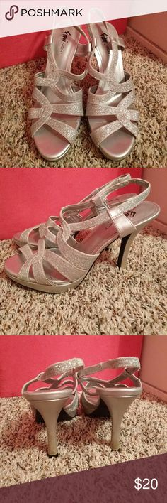 Silver sparkle heels I wore these for my high school dances and they worked perfect! They are really good condition. Shoes Heels