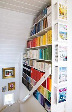 Building book storage into a stairwell. Awesome use of unused space. I need to totally do this!!! Fabu!!!