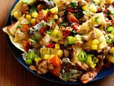 Food Network Magazine came up with 50 nacho recipes and ideas for the ultimate game-day snack.