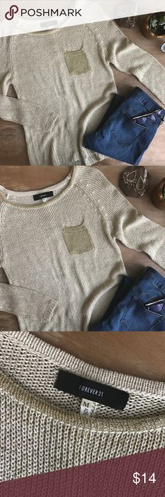 • FOREVER 21 Gold Studded Back Sweater • Gold Sweater from Forever 21. Has a gold pocket on the front and gold studs up the back. Has a few picks, as this sweater texture picks pretty easily, but they can be tucked through the sweater and hidden really well! Size M. Forever 21 Sweaters