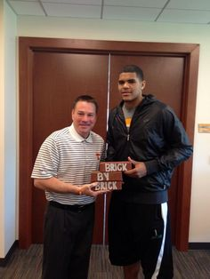 Butch Jones with Tobias Harris