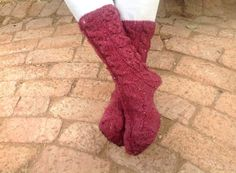 Super comfy slipper socks in this season's favourite colour...with cables and soles.