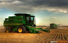 Two John Deere combines harvesting a field of wheat. http://www.mattdobsonphotography.com