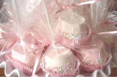 Marshmallows dipped in white chocolate and sprinkles. Pretty for a sweet table or party favors.