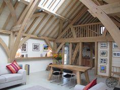Interior of Green Oak Framed Show Barn with Oak Mezzanine Level