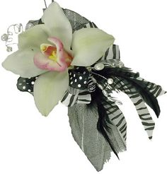 "Our ""New Moon"" Orchid Corsage for Prom 2012! Price ranges from $52 - $65 depending on bracelet."