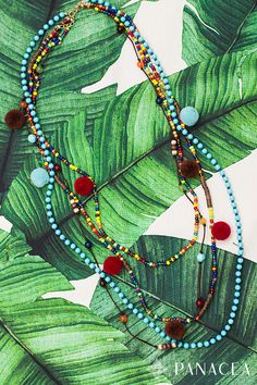Rich in color and even richer in style, this navy multi-row pom-pom beaded necklace oozes boho vibes. Shop now.