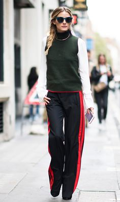 This is how you can pull off track pants for the office if you work in a creative setting - pair them with a blouse and a turtleneck sweater like Olivia. Rebecca Minkoff Shanaya Top $128, Zara Trousers $100, and Urban Collection Sweater $36. (The #1 Trend to Wear for Traveling via @WhoWhatWear)