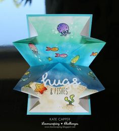 Lawnscaping Challenge: Lawn Fawn Fintastic Friends Hugs and fishes exploding card by Kate Capper.