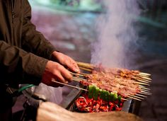 A closer look at the food safety behind China's infamous street food. Is it cat meat or pork? Chinese Street Food, Asian Street Food, Chinese Food, Indian Food Recipes, Asian Recipes, Asian Foods, Food On Sticks, Stick Food, Barbecued Lamb