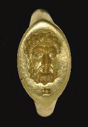 A GREEK ELECTRUM FINGER RING                                                                                                                                                                       CLASSICAL PERIOD, CIRCA 4TH CENTURY B.C.