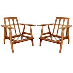 Pair of original Hans Wegner solid oak Cigar lounge chairs.