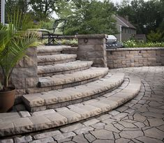 Belgard Mega-Arbel Patio YORKTOWN MATERIALS PINTEREST INSPIRATION Mega-Arbel® gives homeowners the perfectly integrated, natural-looking hardscapes they desire. Its scale is similar to natural flagstone. With its irregular shape and textured surface, Mega-Arbel creates outdoor spaces that flow harmoniously into the surrounding landscape.