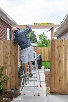 How to create a Simple Pergola Over a Gate. Update your fence by adding a pergola! Process to install new post for fence. Diy Pergola, Curved Pergola, Building A Pergola, Pergola Canopy, Pergola Attached To House, Deck With Pergola, Outdoor Pergola, Pergola Lighting, Cheap Pergola