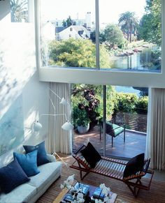 {Houzz Tour: Modern Venice Canals Home Radiates Calm}    This wider perspective of the living room reveals the prized view of the Venice Canals, where docked boats, serene water and picture-perfect scenery add value to the coveted properties in this neighborhood.