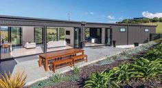 Whangarei home architecturally designed by Mark McLeay and Mark Callander of Creative Arch. Roofing and cladding by Metalcraft in COLORSTEEL® Ironsand. House Cladding, Exterior Cladding, Clad Home, Shipping Container House Plans, Shed Homes, Kit Homes, Steel Roofing, Steel House, Small House Plans