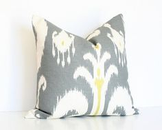 Love the idea of two throw pillows on a bed.  Neat and tidy, matching the shams :)