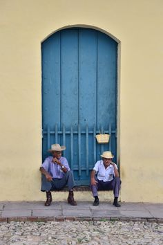 Local men enjoy a cigar in Trinidad