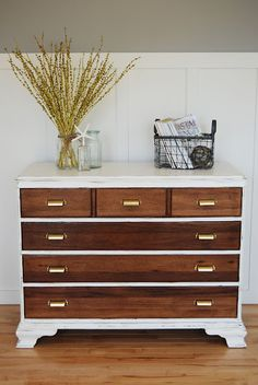 I like this dresser. Great combination of finished shiny wood, weathered white, and bronze handles.