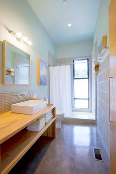 The homeowners built the bathroom storage themselves. By buying some bathroom fixtures from big-box home improvement centers, the couple could splurge on a luxury or two.