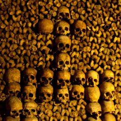 Paris catacombs (16 of 17)    Cross of skulls in wall of Paris catacombs