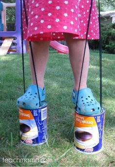 Enjoy the outdoors while you still can before it gets cold! Use items you have at home for some old school fun. These coffee can stilts will keep kids entertained for hours! It's a great kids activity to teach coordination, balance and gross motor skills! #teachmama #kidsactivities #outdoor #kids #activity #playlist #activities #ideas #parents
