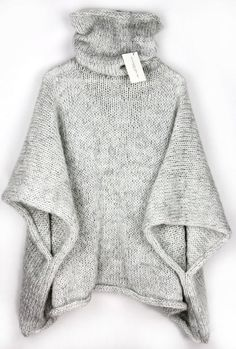 Cuddly knitted poncho for winter with a high collar / knitted cape for . Cuddly knitted poncho for winter with a high collar / knitted cape for the winter season, knitwear made by Alexandra Mil. Loose Sweater, Poncho Sweater, Poncho Pullover, Poncho Outfit, Baby Cardigan, Grey Sweater, Diy Tricot Crochet, Pull Poncho, Warm Sweaters