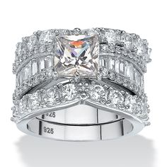 Chic three-piece bridal set features a princess-cut center surrounded by round and baguette cubic zirconia accents.