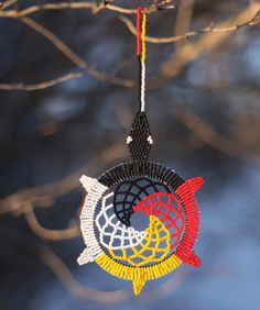 This is a handmade fully beaded dreamcatcher. It measures 7 1/2 from top to bottom and is 3 1/2 wide. It is made using size 11 TOHO beads. The