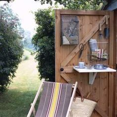 "Using shed door for storage/organization ""you can paint the shed a subdued green or blue to make it appear smaller."""