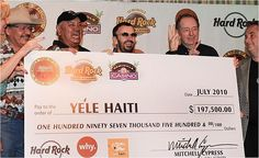 HRH HW HAITI Seminole Hard Rock Hotel & Casino team, with Ringo Starr, donating funds to help in Haiti earthquake relief efforts.