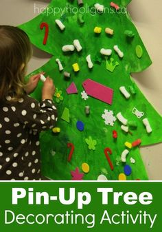 Pin-up Christmas Tree activity.  Terrific activity for home or the classroom.  Great idea to keep little ones busy at a Christmas party too!  The hooligans spent a good couple of hours working on ours! - Happy Hooligans
