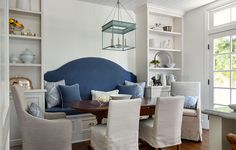 blue and white kitchen/blue banquette/dining room shelves/marble countertops/french doors/Tondro_Buckland_Kitchen_Table.jpg