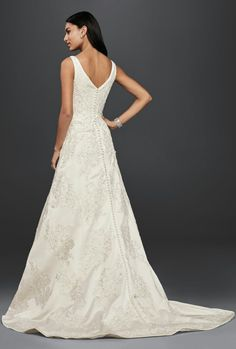 "Gorgeous Sleeveless Lace Wedding Gown With A ""V"" Neckline & Back, Classic A-Line Silhouette, Chapel Train; Oleg Cassini Collection for David's Bridal"