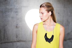 Loving the layered necklace. Statement ink on yellow.