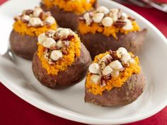 Get Stuffed Sweet Potatoes with Pecan and Marshmallow Streusel Recipe from Food Network