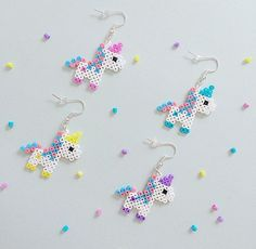 Bubblegum Unicorn Hama Bead Earrings is part of Unicorn crafts Colour Perler beads and silverplated earring hooks, with a rubber stopper on the back Both sides have been ironed for strength Colou - Perler Bead Designs, Hama Beads Design, Pearler Bead Patterns, Perler Patterns, Mini Hama Beads, Diy Perler Beads, Perler Bead Art, Pearler Beads, Fuse Beads