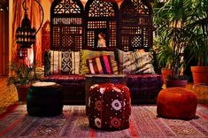 more sophisticated--bit rustic  like the dark wood and rust colors against the brighter orange wall and bright green palm leaves