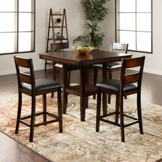 "The Canyon collection is clean and casual with a dark merlot finish, soft sanded corners and dark brown edge burnishing. Sit comfortably around a 40"" square counter height table on counter height stools with beautiful slat backs and cushioned slip seats.Features:Table: Counter-heightDark brown bu..."