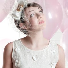 Cute and sassy.  The Jess birdcage veil fascinator is great statement piece  though of course the veiling length and fullness can be scaled back to  whatever size you wish.  It is mounted on a satin band though could be on a  metal one which can be covered in velvet ribbon (£5 additional charge)