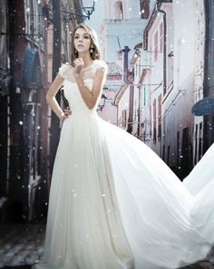 Ball gown dress with mesh neckline. Really loving the shoulders.