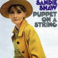 """Sandie Shaw Eurovisiion Song Contest 1967.  """"Puppet on a String"""" is the name of the Eurovision Song Contest-winning song in 1967 by British singer Sandie Shaw.  It was her thirteenth UK single release. The song was a UK Singles Chart number one hit on 27 April 1967, staying at the top for a total of three weeks."""