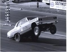 AWB Chevelle drag car lifting the front wheels.