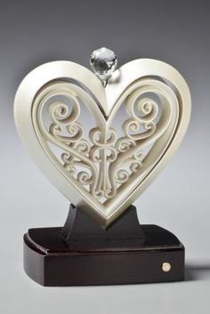 The Unity Heart is a unique way to celebrate the joining of a bride and groom together as one. This multi-piece sculpture is to be assembled during the unity service of the wedding ceremony representing the joining of two into one. The groom places his outer heart in the wood base. The bride then places the more delicate heart inside the groom's heart. The Unity Heart can be displayed in the couple's home after the wedding ceremony as a reminder of their wedding day and the union they…
